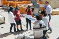 Students learn about harnessing the Sun's power using a Fresnel lens