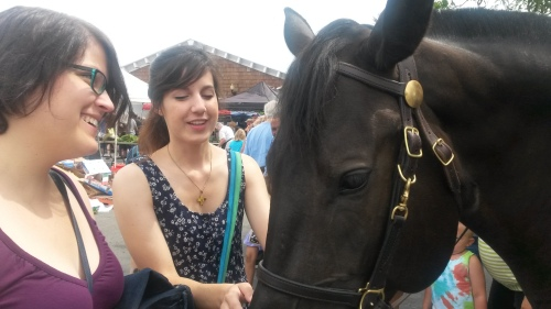 Amber and me petting a horse at the farmer's market