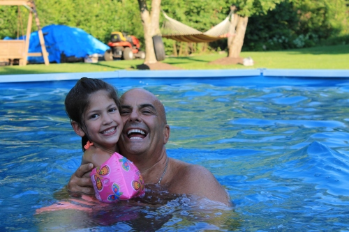 Sammy swimming with his niece's daughter