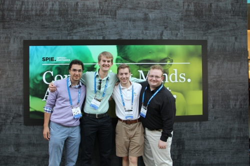 The SOCk officers present at Optics + Photonics, from left to right: Soha Namnabat, Outreach Co-chair this year (CIAN student); myself; Dawson Baker,  our president for SOCk this year; Dale Karas, last year's president.